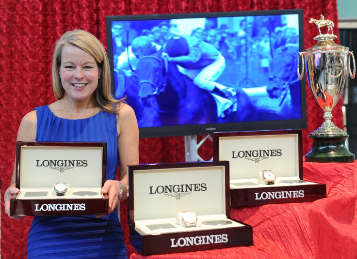 Jennifer Judkins, Longines U.S. Brand President, poses with the Kentucky Derby trophy and Longines timepieces at the Taste of Derby, Thursday, May 2, 2013, in Louisville, Ky.  Longines, the Swiss watch manufacturer known for its luxury timepieces, is the Official Watch and Timekeeper of the 139th annual Kentucky Derby. (Diane Bondareff/Invision for Longines/AP Images)