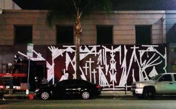 Graffiti artis RETNA exterior mural of Station1640